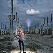 Young girl in casual holding balloon on rope