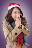 Attractive Asian woman with christmas hat, closeup portrait.