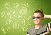 Happy young woman with glasses and casual clothes icons concept on green background