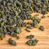 High quality dried green tea closeup on a wooden background