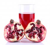 Ripe pomegranate and glass of juice isolated on white