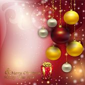 Christmas Background Of Glare With Hanging Colorful Christmas Ba