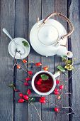 image of home remedy  - fresh tea with rosehip on a table - JPG