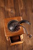 Whole and ground coffee beans from a hand wood coffee grinder