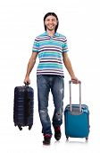 Young man travelling with suitcases isolated on white