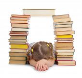 Sleeping little girl with books isolated
