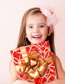 Smiling Adorable Little Girl With Christmas Gift Box