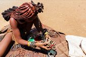 Himba Girl With Souvenirs For Sale In Traditional Village