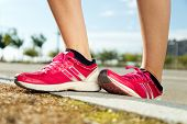 Runner Feet Preparing For Running On Road Closeup On Shoe.
