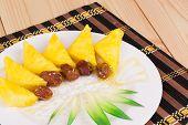 Fresh tropical fruits pineapple, dates