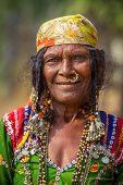 HAMPI, KARNATAKA, INDIA - FEBRUARY 1, 2013: Unidentified old Banjari woman wearing traditional dress poses for the camera in Hampi, Karnataka, India on February 1, 2013.