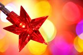 Christmas star shaped lights on red background with copy space