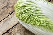 Fresh Green Cabbage On Wooden Table