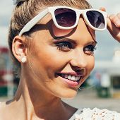 Young Woman With Sunglasses Smiling