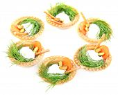 Tartlets with greens and vegetables with sauce isolated on white