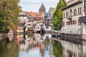 Colorful Houses Reflecting In Water Of River Ill In Strasbourg