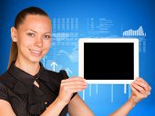 Beautiful businesswoman in dress holding tablet pc. Arrows and figures as backdrop