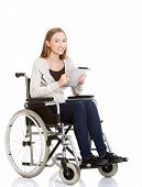 Young woman in wheelchair holding a tablet.