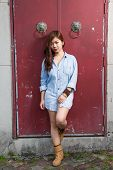 picture of filipina  - Asian woman in front of traditional Chinese door with ornate lion head knockers - JPG