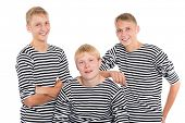 Group of smiling young men in striped shirt isolated on white background. Two of the boys twin brothers.