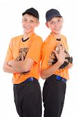 Young boys twin brothers in the form of a baseball game. Brothers in eighteen years.