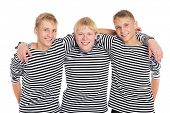 Smiling boys in striped shirt isolated on white background.Two of the boys twin brothers.