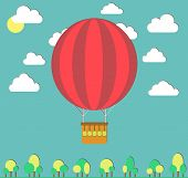 Hot air balloon in the sky and small trees