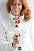 Cute Hipster Girl Holding A Lollipop