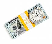 Time is money loan concept background - stopwatch and stack of new 100 US dollars 2013 edition banknotes (bills) bundles isolated on white