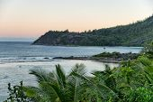 Extensive View of Beautiful Beach with Green Hills and Trees on the Side at Mahe Island, Seychelles