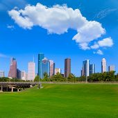 Houston skyline blue sky and Memorial park turf at Texas USA US