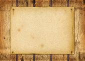 Blank vintage poster nailed on a wood board pic.
