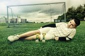 young football player laying on grass