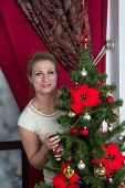 Adult Woman decorate Christmas tree at home