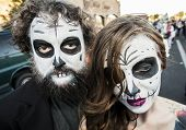 Couple In Dia De Los Muertos Face Paint