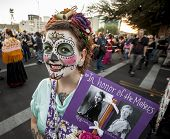 Woman With Sign In Dia De Los Muertos Makeup