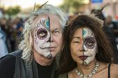 Couple In Dia De Los Muertos Makeup