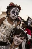 Woman And Child In Dia De Los Muertos Makeup