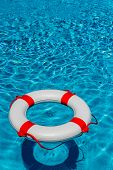 an emergency tire floating in a swimming pool. photo icon for rescue and crisis management in the financial crisis and banking crisis.