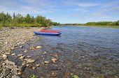 Tourist Kayaks At Pebble River Banks.
