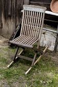 Old Chair And Guitar In Garden