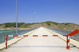 stock photo of safety barrier  - Safety barrier at a dam production of electrical energy - JPG