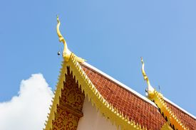 stock photo of apex  - Gable apex on the roof of royal temple in Chiang Rai thailand - JPG