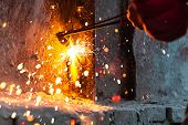 foto of torches  - worker cutting steel board using metal torch - JPG