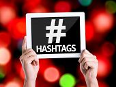 picture of hashtag  - Tablet pc with text Hashtags with bokeh background - JPG
