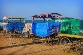 stock photo of tamil  - Old carts on beach in Pondicherry - JPG