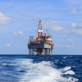 image of drilling platform  - Offshore Jack Up Drilling Rig Over The Production Platform in The Middle of The Sea - JPG