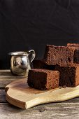 stock photo of guinness  - chocolate brownie with dark beer on a black background - JPG