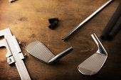 stock photo of work bench  - Assembling golf clubs or golf club making - JPG