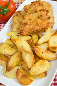 foto of potato chips  - morsels of cod fish with chips potatoes and rosemary - JPG
